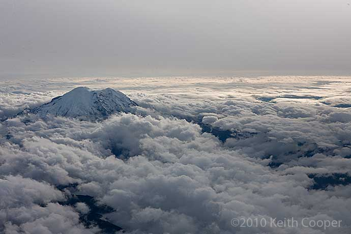 mt rainier pokes through clouds
