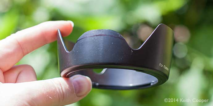 initial estimate of how much to modify the lens hood