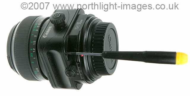 removing screws from Canon tilt shift lens