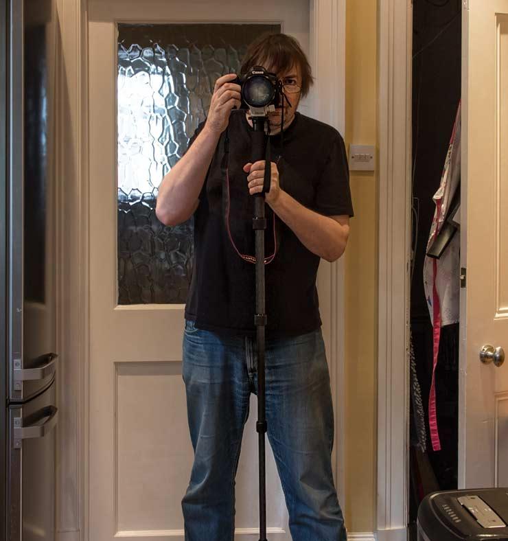 holding a camera monopod