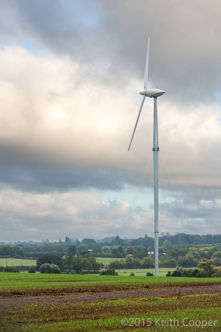 wind turbine in field with early morning cloud