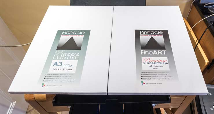 two boxes of A3 photo paper