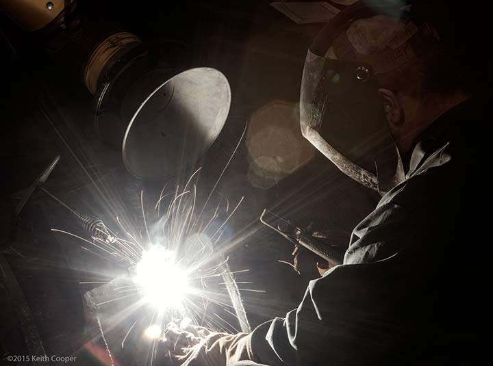 photo of welder, with light application of Topaz ReStyle