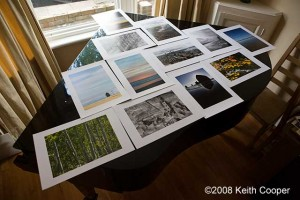 test prints drying on the top of a piano