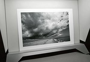 large black and white print in viewing stand