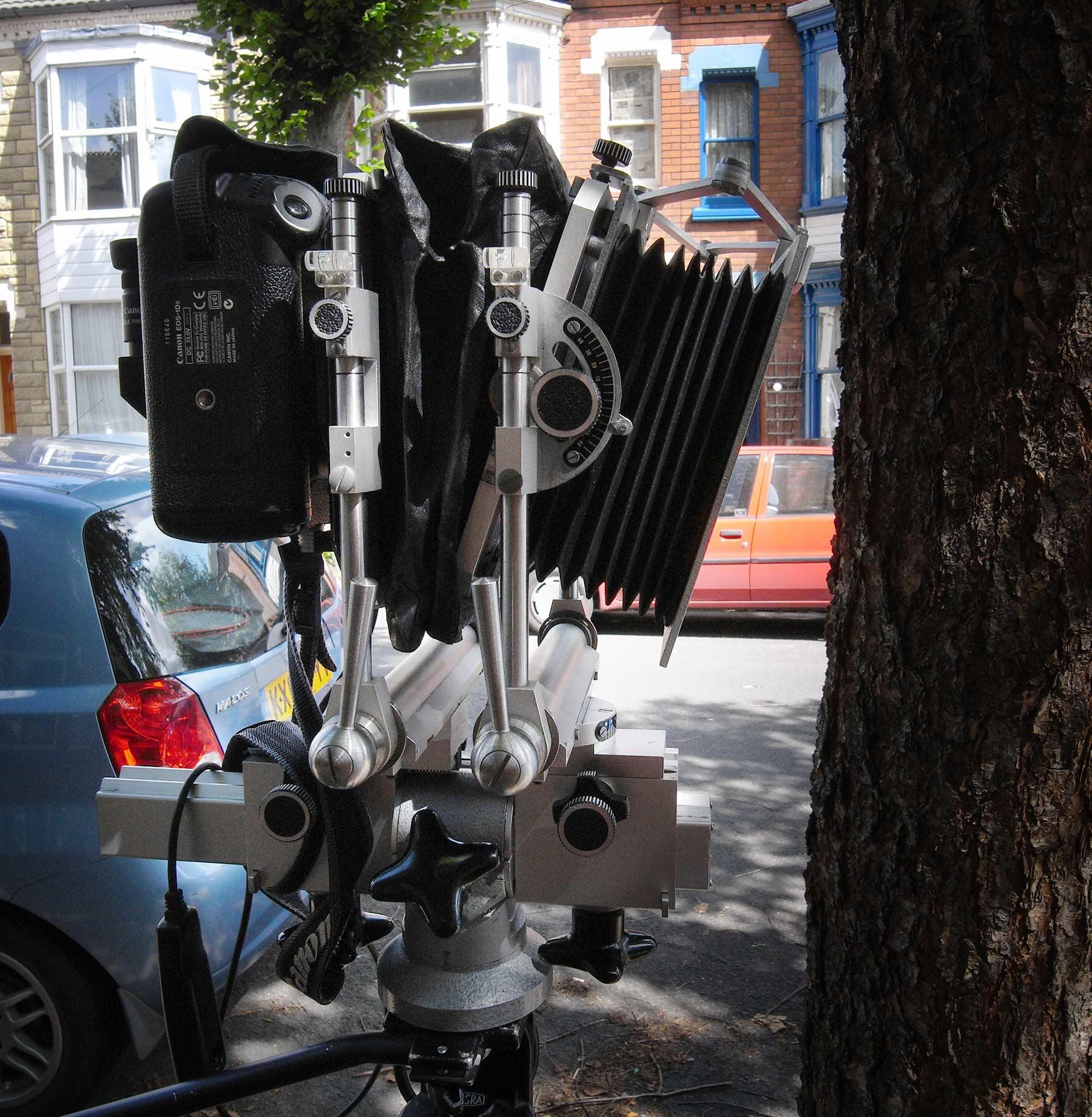 Camera with downwards tilted lens