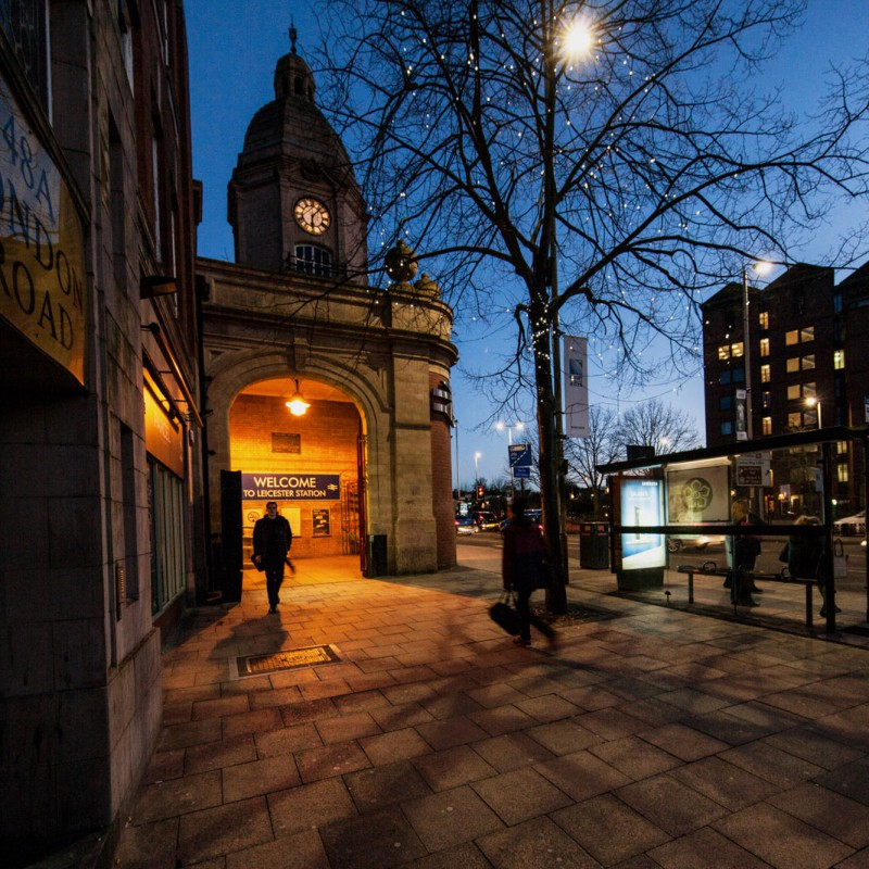 The entrance to Leicester Railway Station at dusk