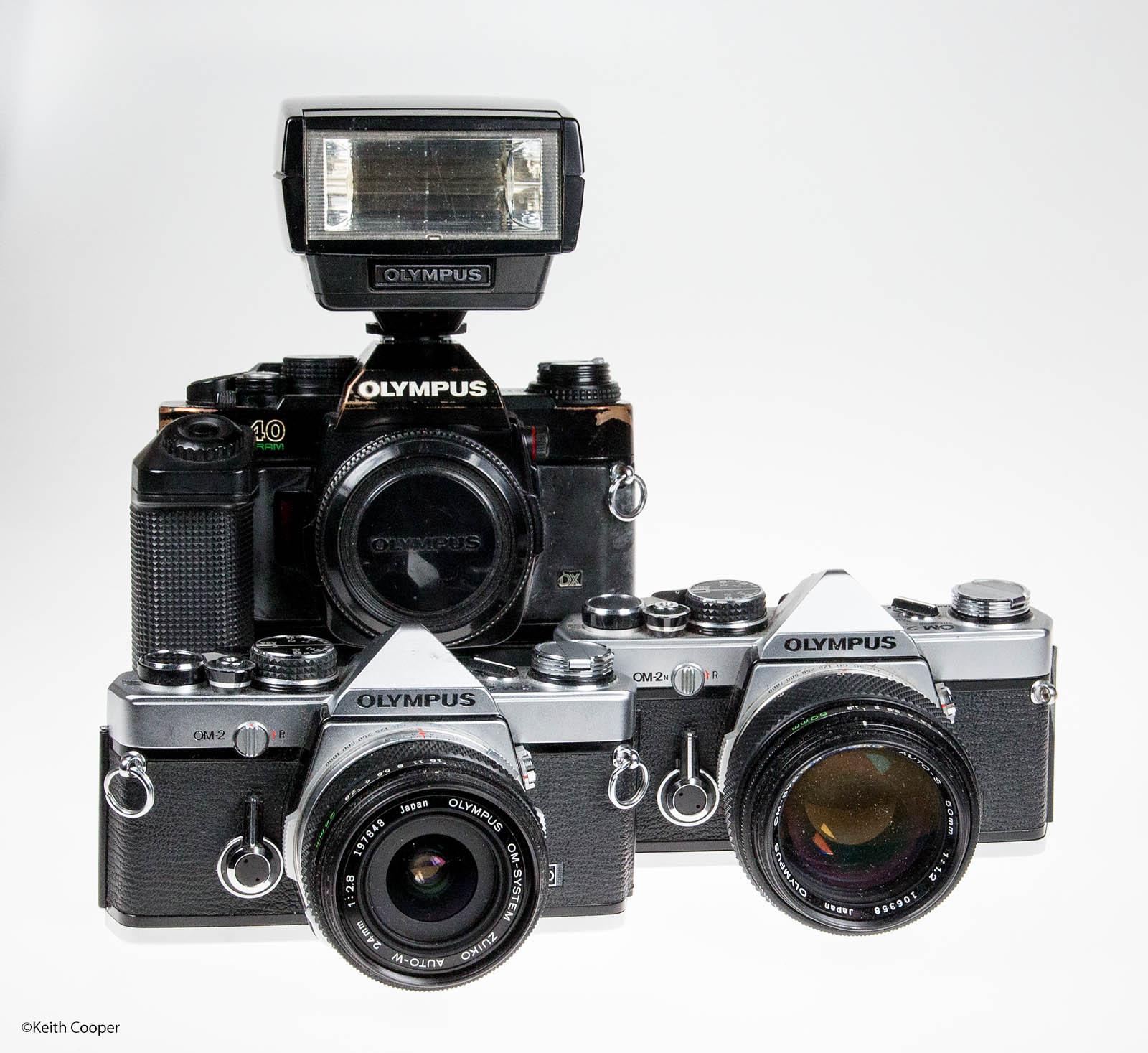 three olympus film cameras
