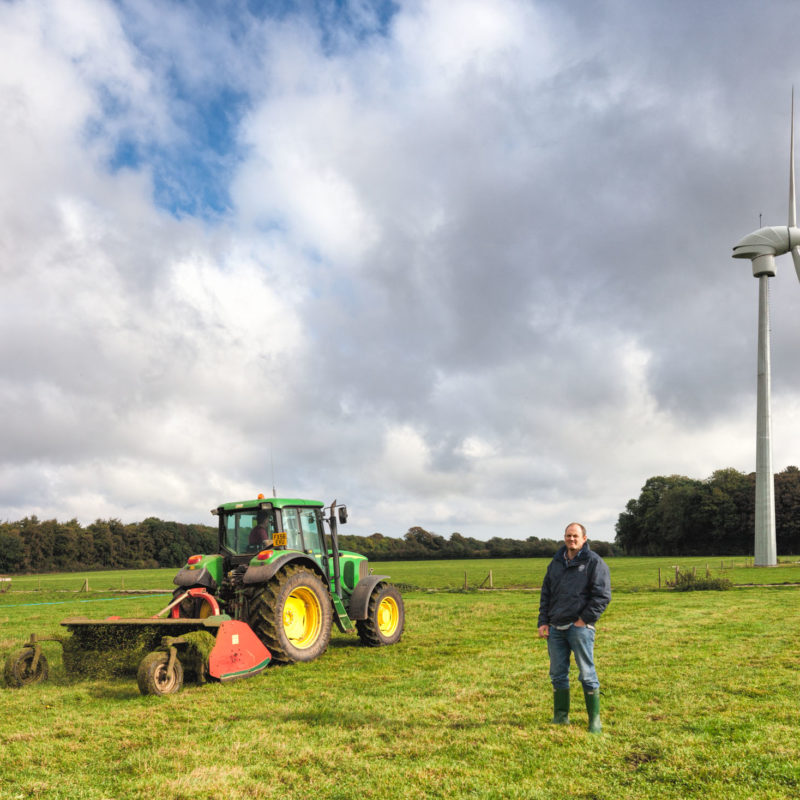 Tractor, farmer and wind turbine