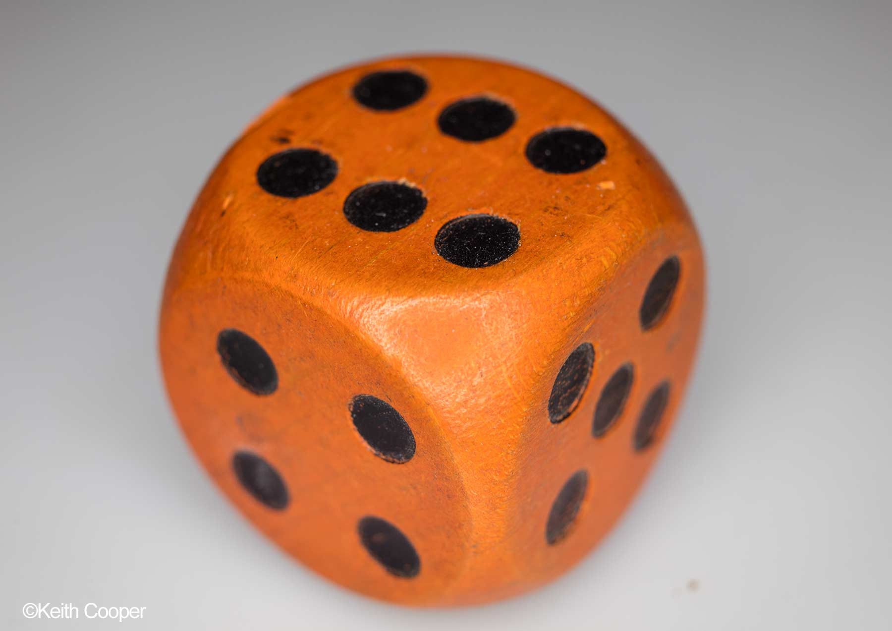 orange wooden die